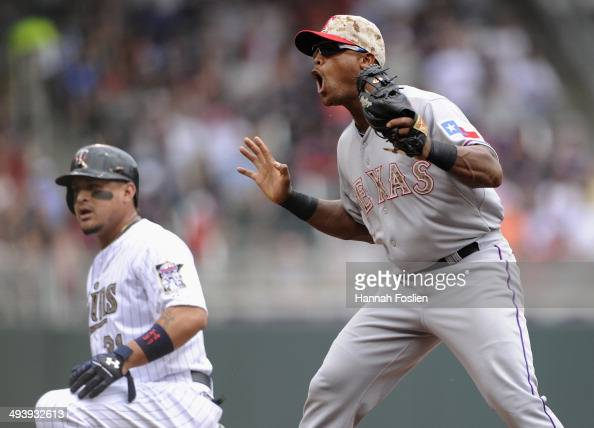 Adrian Beltre of the Texas Rangers reacts as Oswaldo Arcia of the Minnesota Twins is called safe at third base during the first inning of the game on...
