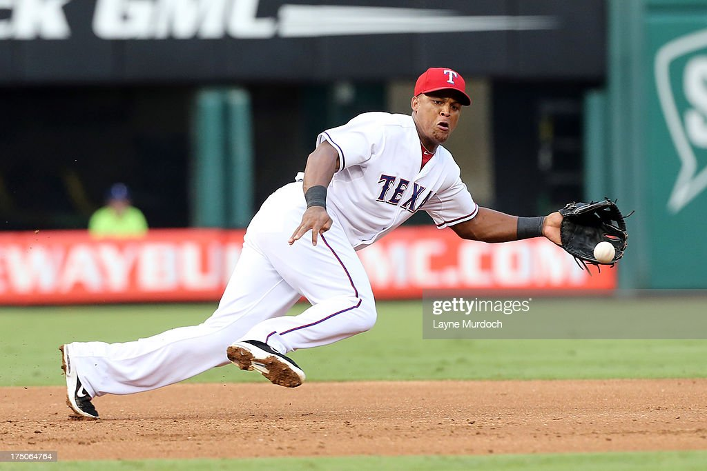 <a gi-track='captionPersonalityLinkClicked' href=/galleries/search?phrase=Adrian+Beltre&family=editorial&specificpeople=202631 ng-click='$event.stopPropagation()'>Adrian Beltre</a> # 29 of the Texas Rangers runs down a hit against the Los Angeles Angels of Anaheim on July 30, 2013 at the Rangers Ballpark in Arlington in Arlington, Texas.