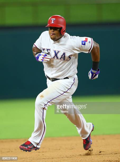 Adrian Beltre of the Texas Rangers runs too third base in the seventh inning against the Chicago White Sox at Globe Life Park in Arlington on August...