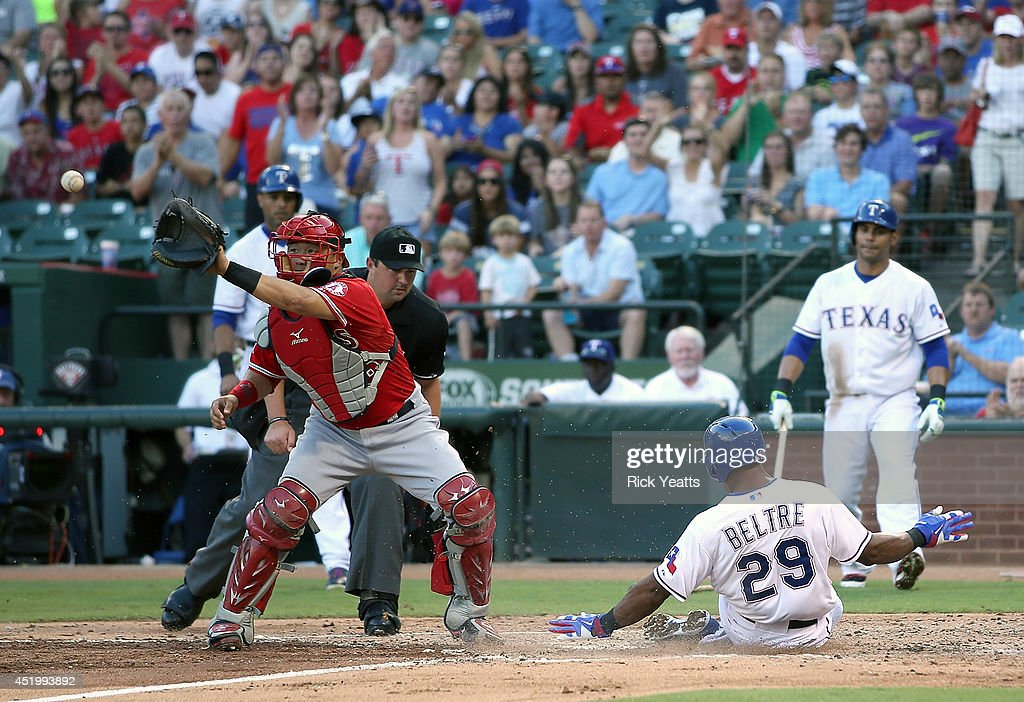 <a gi-track='captionPersonalityLinkClicked' href=/galleries/search?phrase=Adrian+Beltre&family=editorial&specificpeople=202631 ng-click='$event.stopPropagation()'>Adrian Beltre</a> #29 of the Texas Rangers slides in safe in the first inning against <a gi-track='captionPersonalityLinkClicked' href=/galleries/search?phrase=Hank+Conger&family=editorial&specificpeople=713039 ng-click='$event.stopPropagation()'>Hank Conger</a> #16 of the Los Angeles Angels of Anaheim on a two run double hit by Jake Smolinski at Globe Life Park in Arlington on July 10, 2014 in Arlington, Texas.