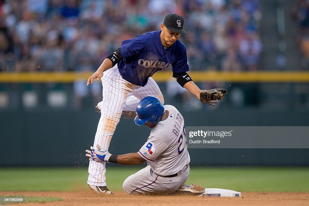Adrian Beltre #29 of the Texas Rangers slides into second base and breaks up a double play attempt and force out by Cristhian Adames #18 of the Colorado Rockies in the fourth inning of a game at Coors Field on August 8, 2016 in Denver, Colorado.