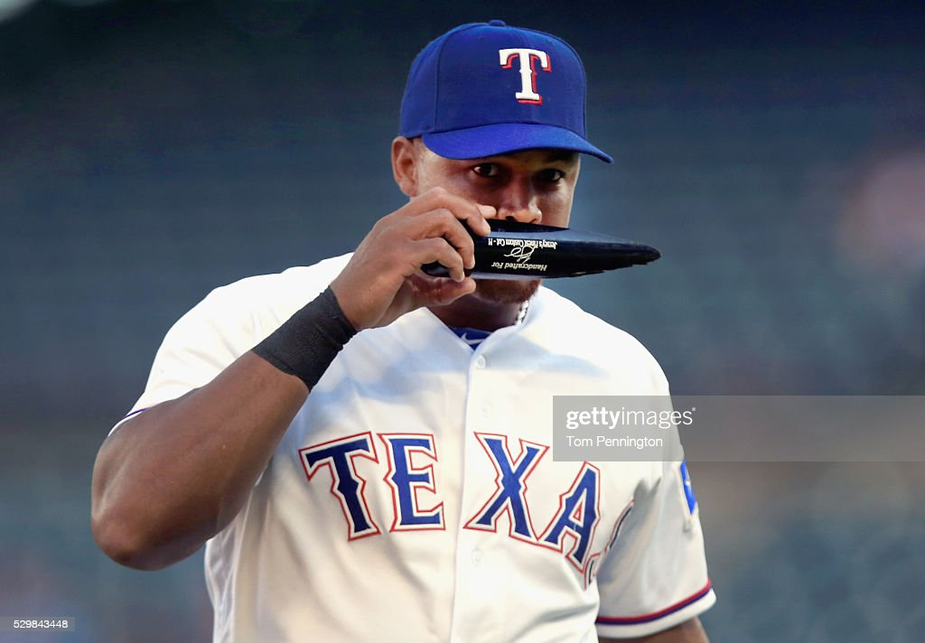Adrian Beltre #29 of the Texas Rangers smells a piece of a broken bat against the Chicago White Sox in the top of the first inning at Globe Life Park in Arlington on May 9, 2016 in Arlington, Texas.