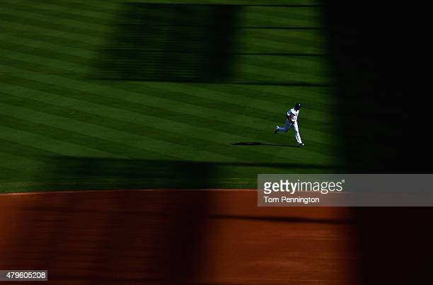 Adrian Beltre of the Texas Rangers sprints across the field before taking on the Los Angeles Angels at Globe Life Park in Arlington on July 5 2015 in...