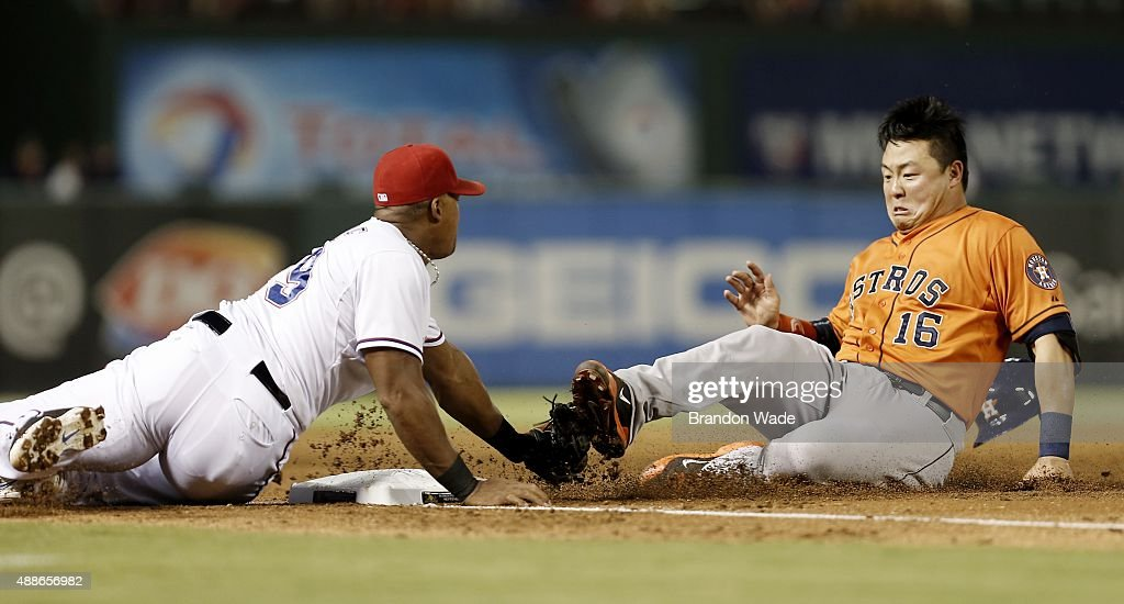 Adrian Beltre of the Texas Rangers tags out Hank Conger of the Houston Astros at third during the third inning of a baseball game against the Houston...