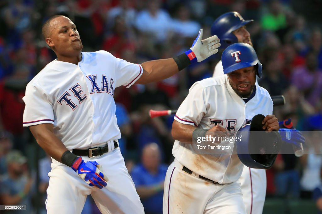 Adrian Beltre #29 of the Texas Rangers takes a swipe at Elvis Andrus #1 of the Texas Rangers after Andrus took his batting helmet in the bottom of the third inning at Globe Life Park in Arlington on August 16, 2017 in Arlington, Texas.