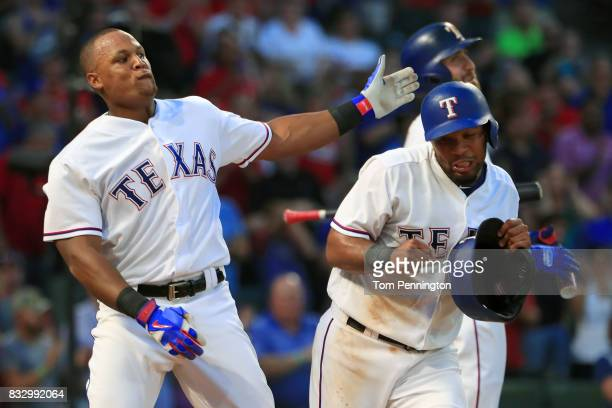 Adrian Beltre of the Texas Rangers takes a swipe at Elvis Andrus of the Texas Rangers after Andrus took his batting helmet in the bottom of the third...