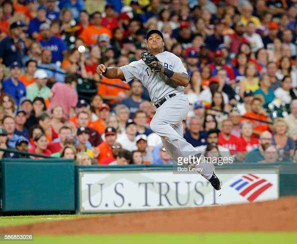 Adrian Beltre of the Texas Rangers throws to first base in the fifth inning but able to retire Carlos Correa of the Houston Astros at Minute Maid...