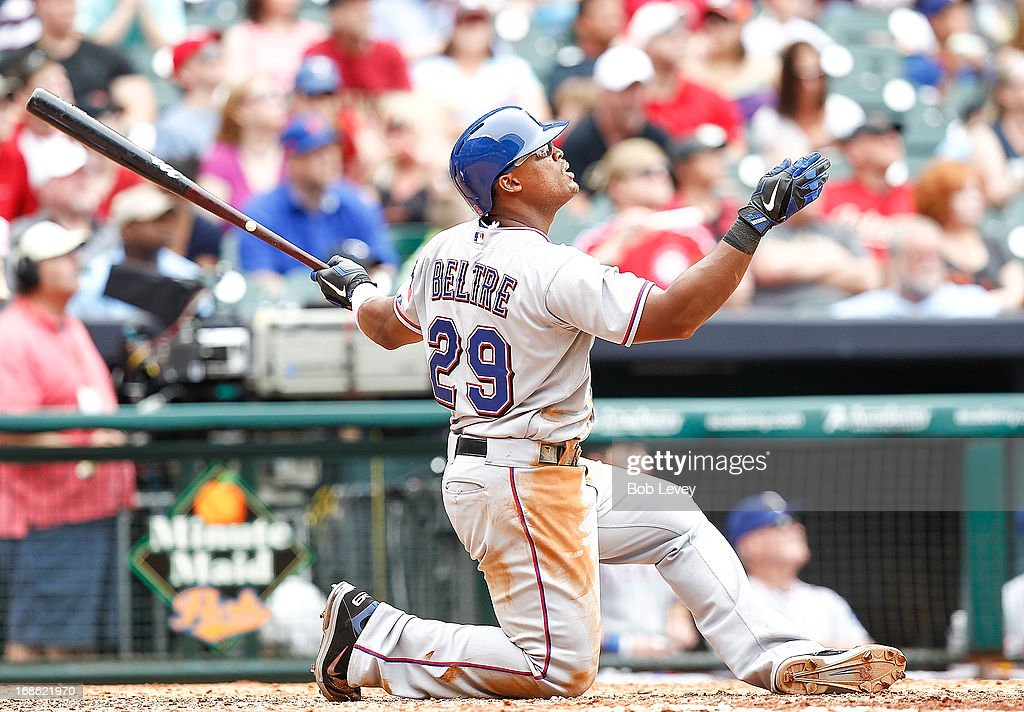 Adrian Beltre #29 of the Texas Rangers watches as he hits a three run home run that was initially called a double at Minute Maid Park on May 12, 2013 in Houston, Texas. After review, umpires ruled a home run.