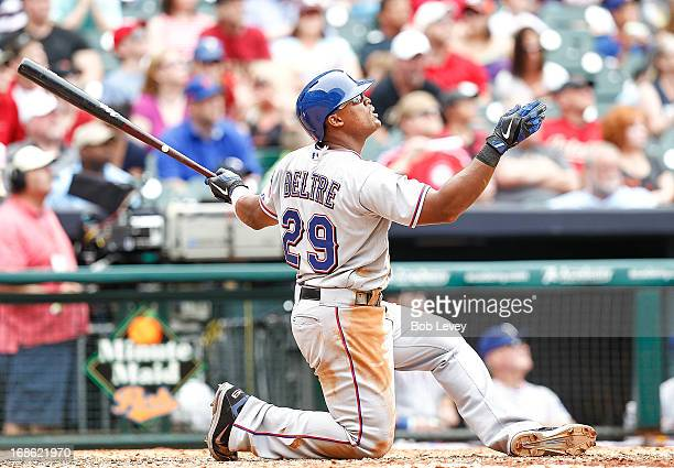 Adrian Beltre of the Texas Rangers watches as he hits a three run home run that was initially called a double at Minute Maid Park on May 12 2013 in...