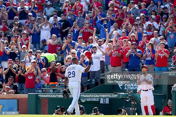 Adrian Beltre of the Texas Rangers waves to fans as he leaves the game against the Tampa Bay Rays in the top of the fourth inning at Globe Life Park...