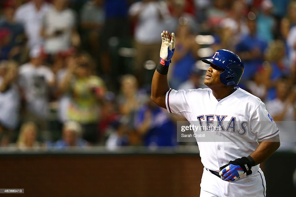Adrian Beltre #29 of the Texas Rangers waves to the crowd after hitting a home run to complete the cycle in the fifth inning during a game against the Houston Astros at Globe Life Park in Arlington on August 3, 2015 in Arlington, Texas.
