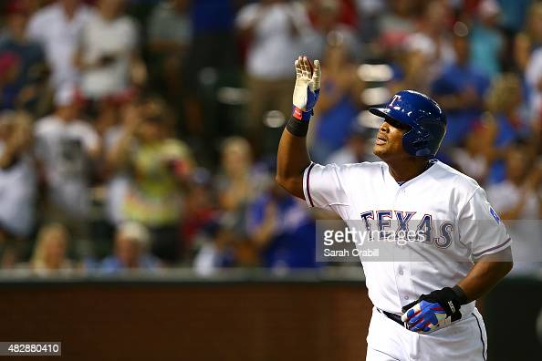 Adrian Beltre of the Texas Rangers waves to the crowd after hitting a home run to complete the cycle in the fifth inning during a game against the...