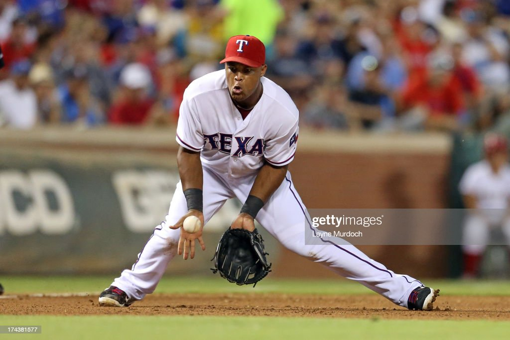Adrian Beltre #29, third baseman for the Texas Rangers is charged with an error on a hit by Brent Lillibridge of the New York Yankees on July 24, 2013 at the Rangers Ballpark in Arlington in Arlington, Texas.