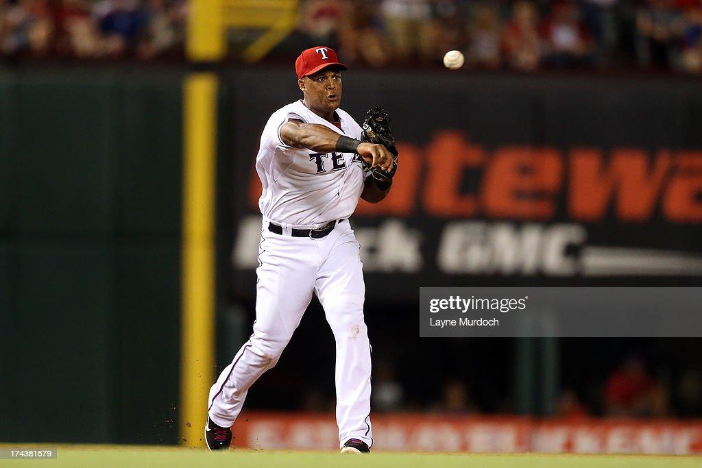 Adrian Beltre #29, third baseman for the Texas Rangers throw out Ichiro Suzuki of the New York Yankees on July 24, 2013 at the Rangers Ballpark in Arlington in Arlington, Texas.