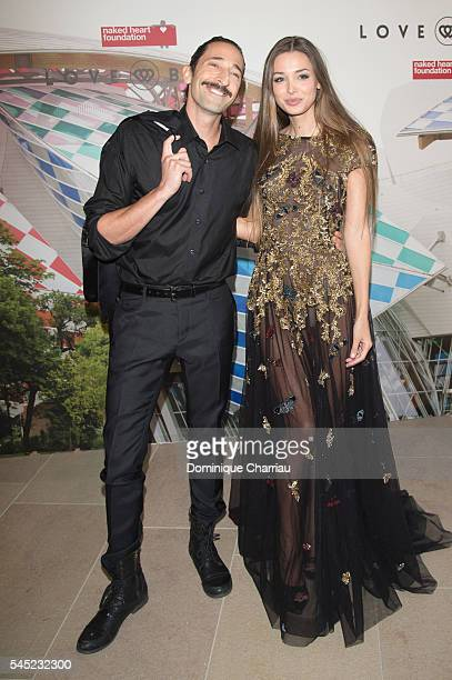 Adrian Brody and Lara Leito attend the 'The Art of Giving' Love Ball Naked Heart Foundation Photo Call as part of Paris Fashion Week Haute Couture...