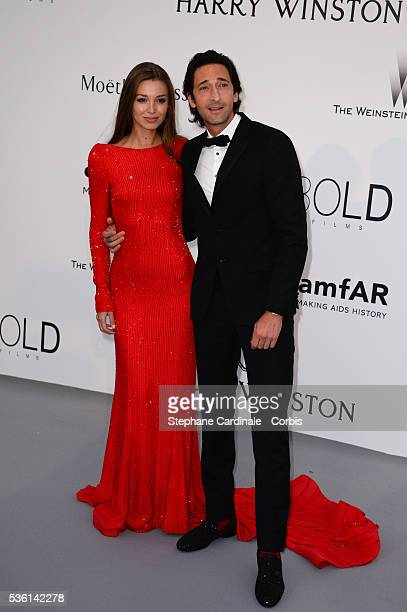 Adrian Brody and Lara Leito attends the AmfAR Red Carpet during the 68th Cannes Film Festival on May 21 2015 in Cannes France