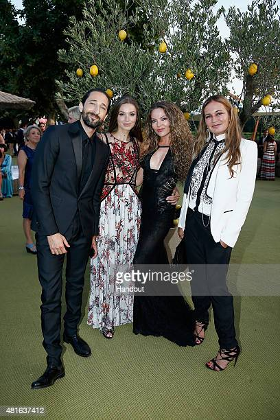Adrian Brody Lara Leito and Eva Cavalli pose as they attend a cocktail reception during The Leonardo DiCaprio Foundation 2nd Annual SaintTropez Gala...