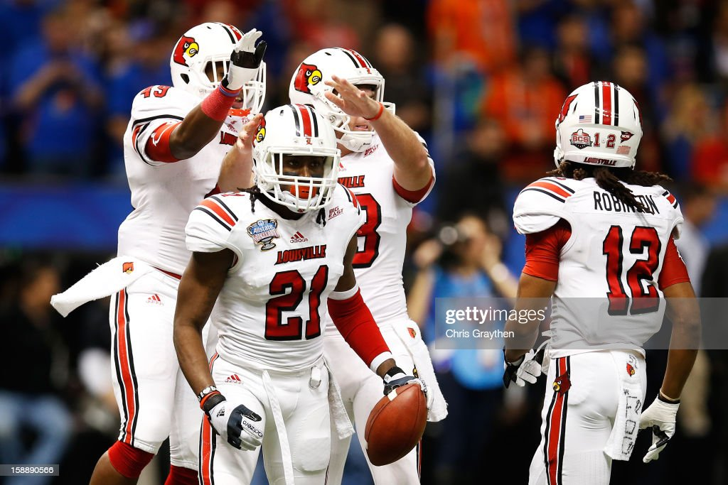 Adrian Bushell #21 of the Louisville Cardinals reacts after downing the ball on the three yard line during the Allstate Sugar Bowl against the Florida Gators at Mercedes-Benz Superdome on January 2, 2013 in New Orleans, Louisiana.
