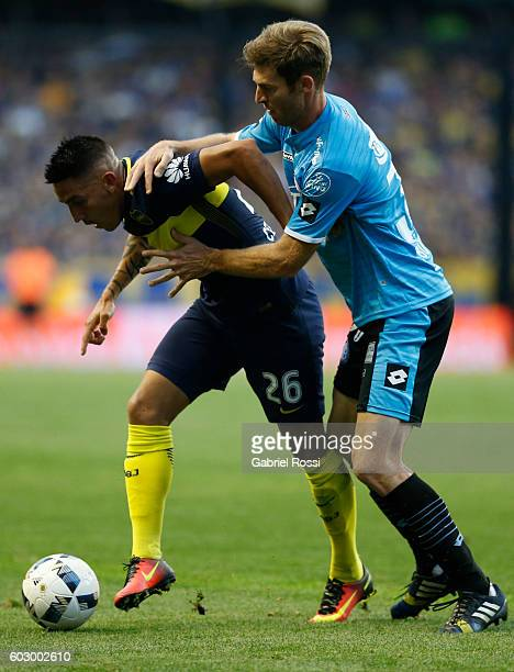Adrian Centurion of Boca Juniors fights for the ball with Mario Bolatti of Belgrano during a match between Boca Juniors and Belgrano as part of...