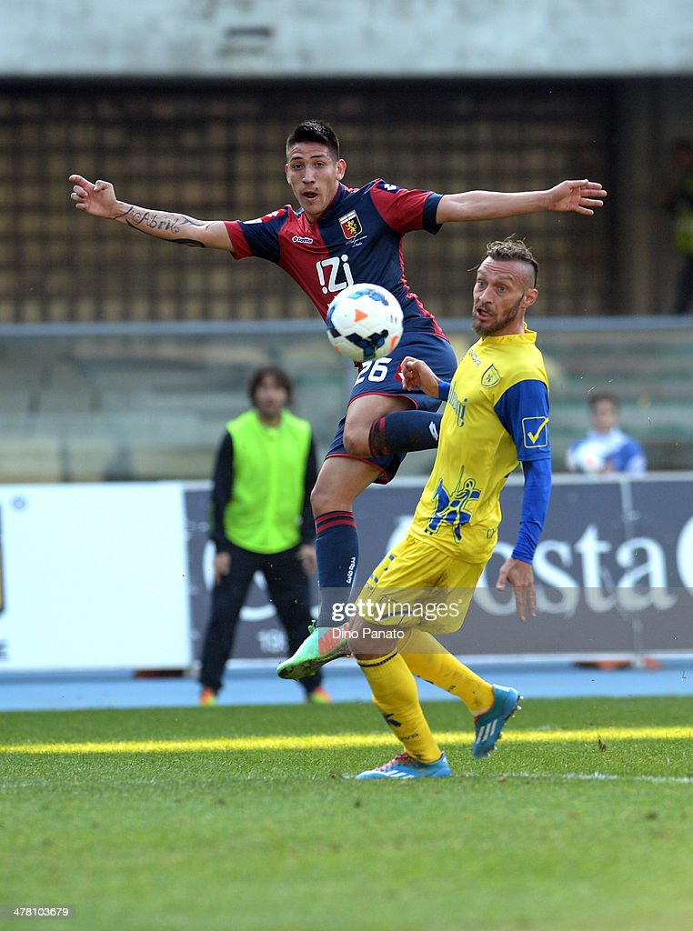 Adrian Centurion (L) of Genoa CFC battles for the ball with <a gi-track='captionPersonalityLinkClicked' href=/galleries/search?phrase=Tiberio+Guarente&family=editorial&specificpeople=4667653 ng-click='$event.stopPropagation()'>Tiberio Guarente</a> of Chievo Verona during the Serie A match between AC Chievo Verona and Genoa CFC at Stadio Marc'Antonio Bentegodi on March 9, 2014 in Verona, Italy.