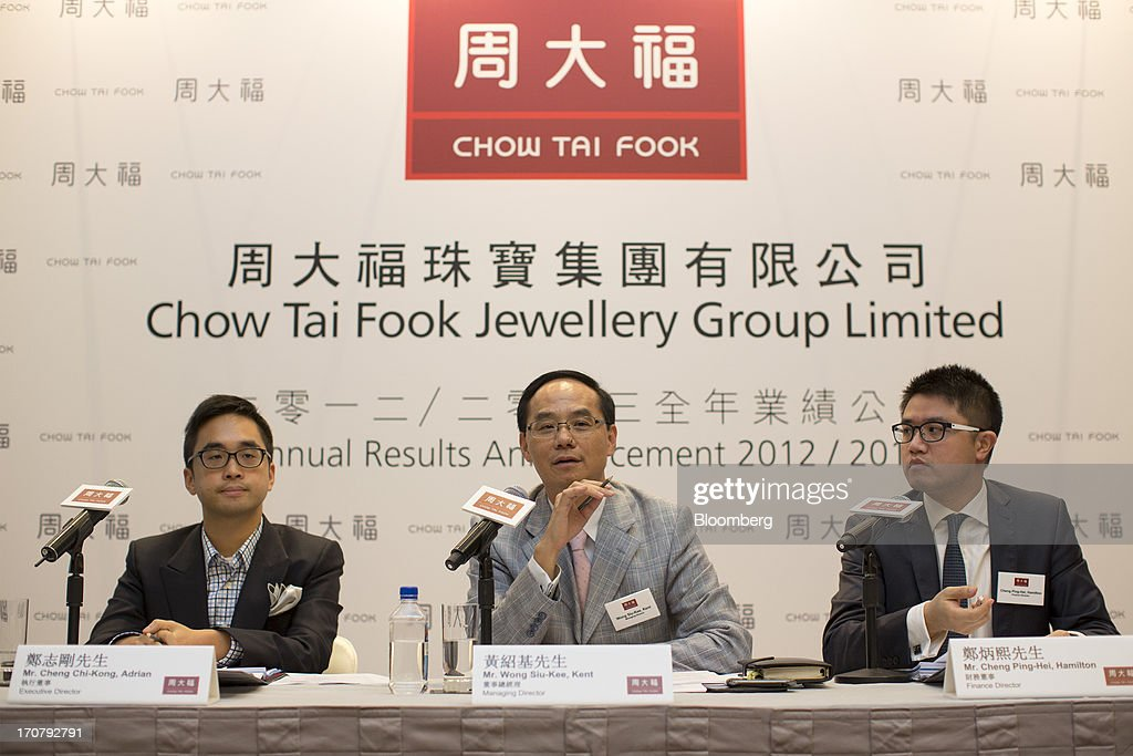 Adrian Cheng, executive director of Chow Tai Fook Jewellery Group Ltd., from left, Kent Wong, managing director, and Hamilton Cheng, finance director, attend the company's annual results news conference in Hong Kong, China, on Monday, June 18, 2013. Chow Tai Fook, the worlds largest listed jewelry chain, reported a 13 percent decline in profit on higher costs and weaker consumer spending. Photographer: Jerome Favre/Bloomberg via Getty Images