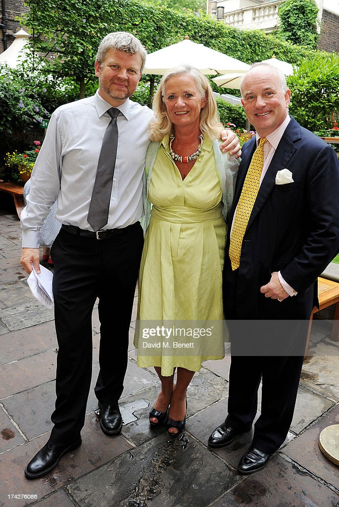 Adrian Chiles, Dogs Trust CEO Clarissa Baldwin and Dogs Trust Chairman Philip Daubeny attend the Dogs Trust Honours held at Home House on July 23, 2013 in London, England.
