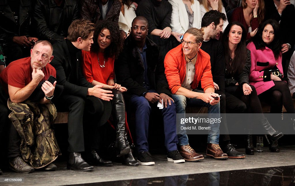 Adrian Clark Oliver Cheshire guests Oliver Proudlock Ralf Little Liberty Shaw and Amy Molyneaux sit in the front row during the Superdry AW14 catwalk...