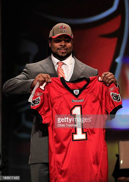 Adrian Clayborn #20 overall pick by the Tampa Bay Buccaneers poses on stage on stage during the 2011 NFL Draft at Radio City Music Hall on April 28...