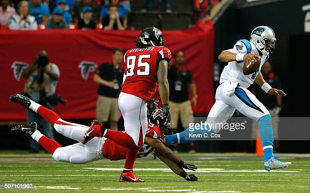 Adrian Clayborn and Jonathan Babineaux of the Atlanta Falcons chase Cam Newton of the Carolina Panthers at the Georgia Dome on December 27 2015 in...