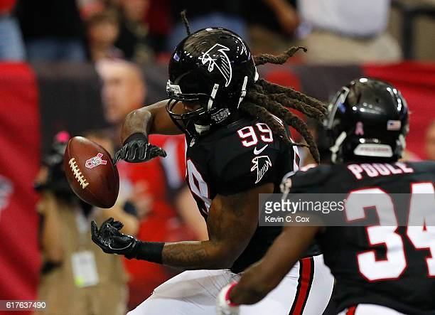 Adrian Clayborn of the Atlanta Falcons reacts after scooping up a fumble on the way to scoring a touchdown against he San Diego Chargers at Georgia...