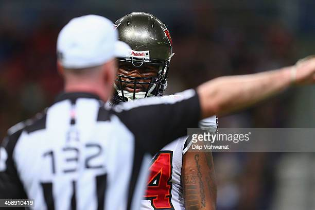 Adrian Clayborn of the Tampa Bay Buccaneers confronts the referee after being called for roughing the passer against the St Louis Rams at the Edward...
