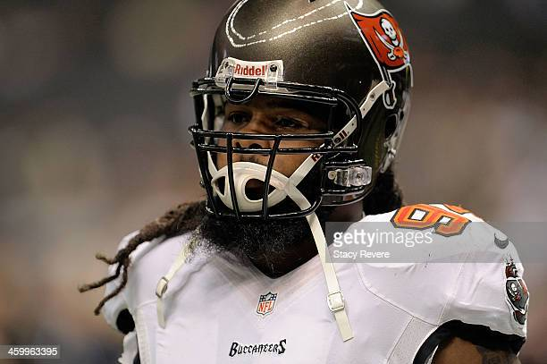 Adrian Clayborn of the Tampa Bay Buccaneers participates in warmups prior to a game against the New Orleans Saints at the MercedesBenz Superdome on...
