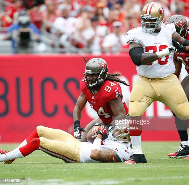 Adrian Clayborn of the Tampa Bay Buccaneers sacks Colin Kaepernick of the San Francisco 49ers during the game at Raymond James Stadium on December 15...