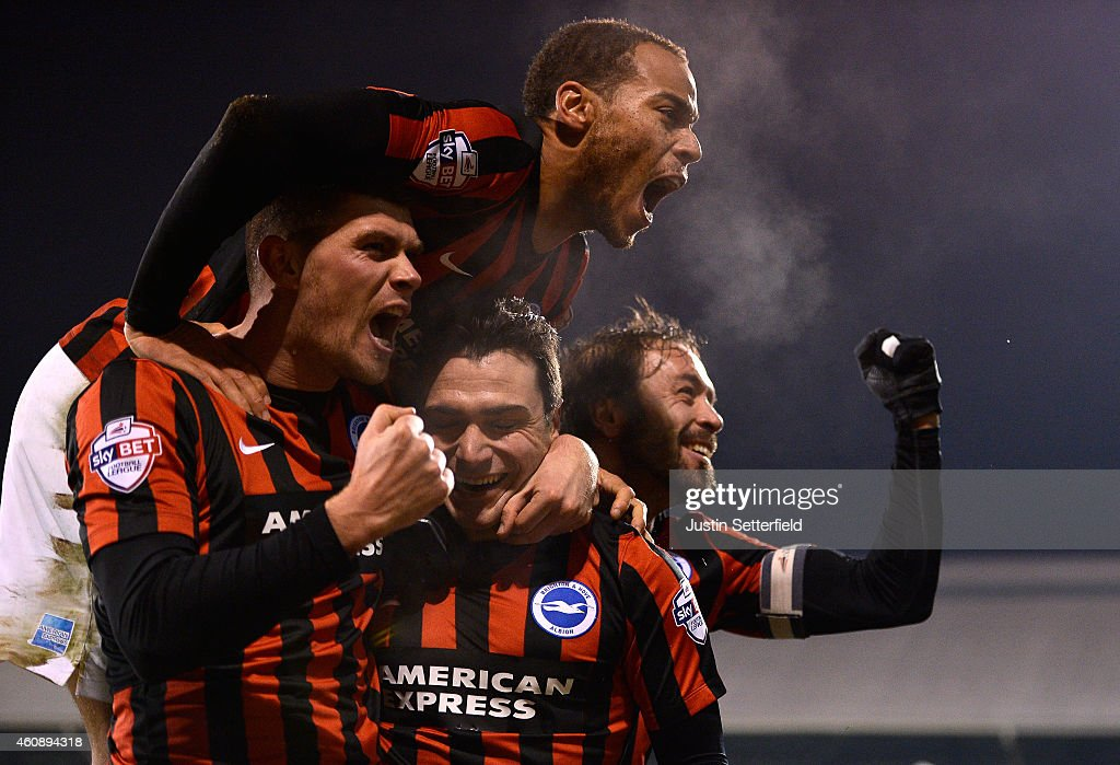 Adrian Colunga of Brighton celebrates scoring the first goal during the Sky Bet Championship match between Fulham and Brighton Hove Albion at Craven...