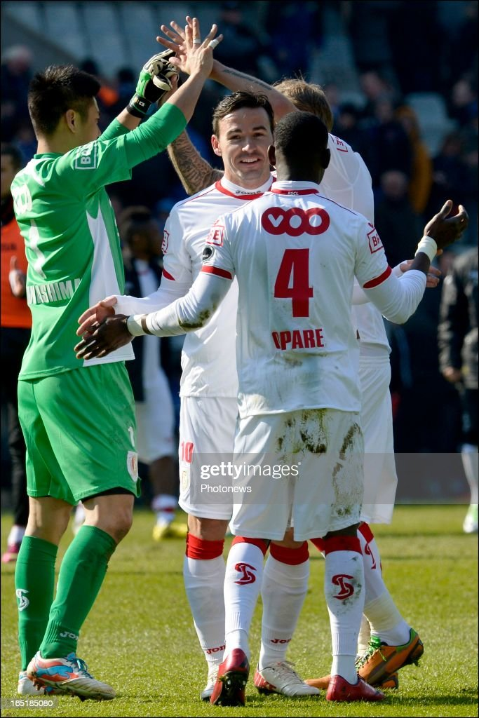 Adrian Cristea of Standard celebrates the victory with Daniel Opare of Standard after the Jupiler League match between Club Brugge and Standard de Liege on April 01, 2013 in the Jan Breydel Stadium in Brugge, Belgium.