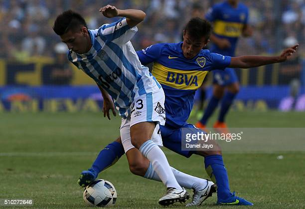 Adrian Cubas of Boca Juniors and Lucas Villalba of Atletico Tucuman vie for the ball during a match between Boca Juniors and Atletico Tucuman as part...