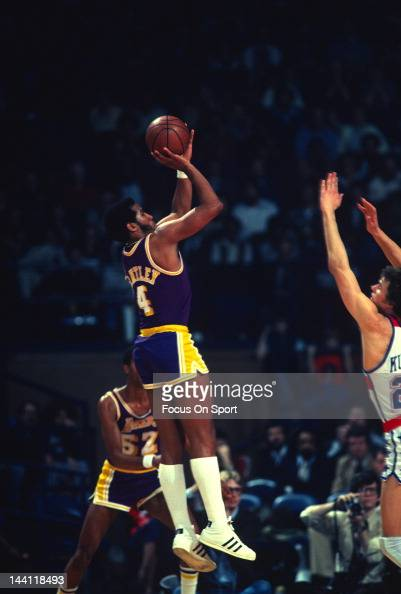 Adrian Dantley of the Los Angeles Lakers shoots over Mitch Kupchak of the Washington Bullets during an NBA basketball game circa 1978 at the Capital...