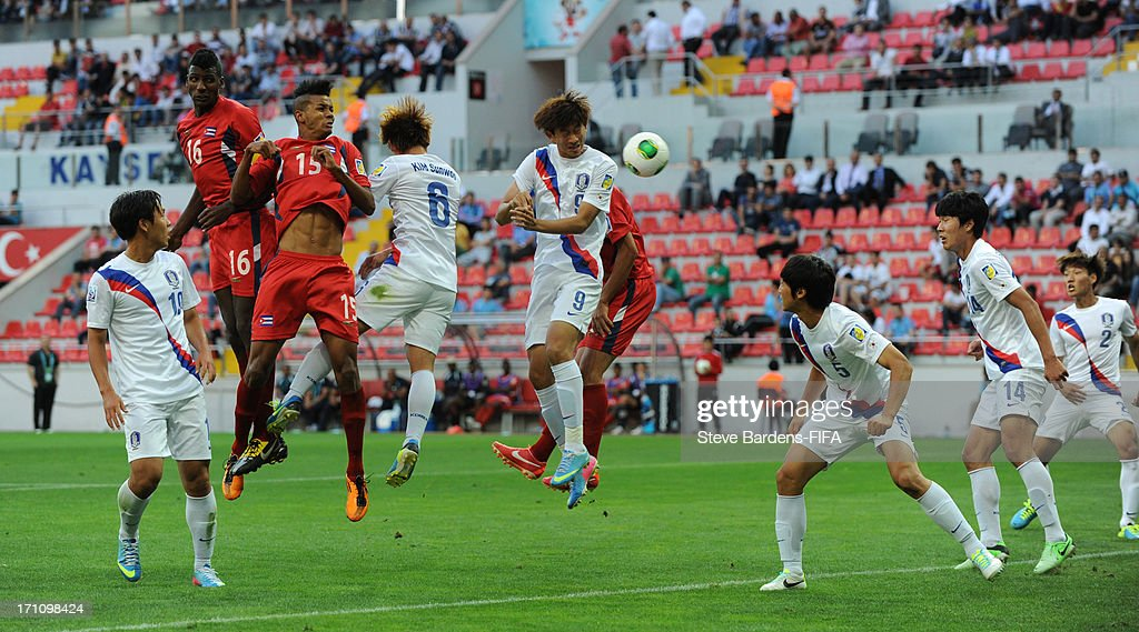 Adrian Diz of Cuba (3rd L) wins a header during the Group B match between Cuba and Korea Republic at Kadir Has Stadium on June 21, 2013 in Kayseri, Turkey.