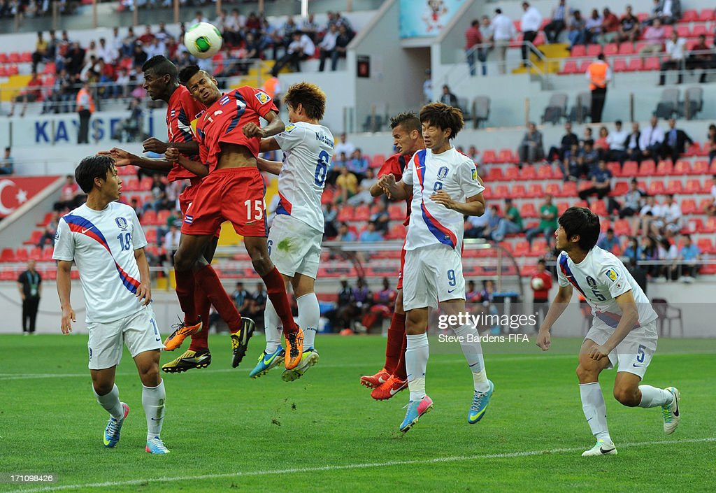 Adrian Diz of Cuba (3rd L) wins a header during the Group B match between Cuba and Korea Republic at Kadir Has Stadium on June 21, 2013 in Kayseri, Turkey.