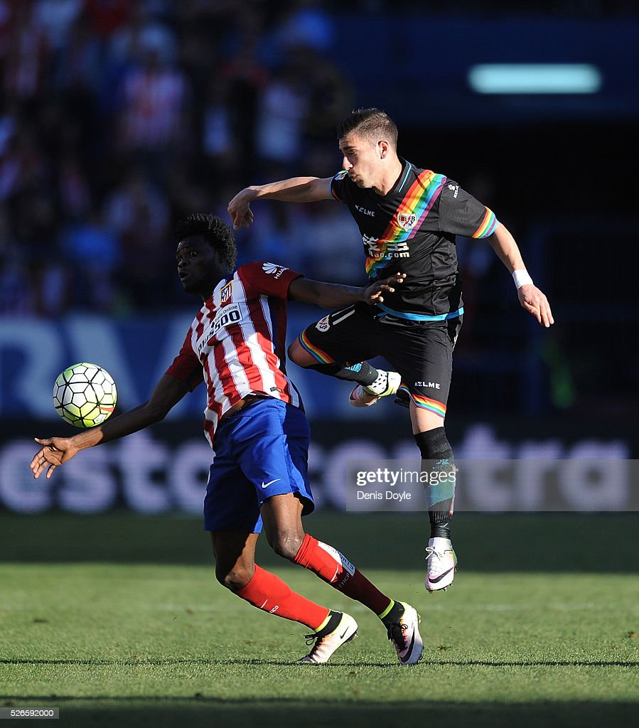 Adrian Embarba of Rayo Vallecano tackles <a gi-track='captionPersonalityLinkClicked' href=/galleries/search?phrase=Thomas+Partey&family=editorial&specificpeople=13560196 ng-click='$event.stopPropagation()'>Thomas Partey</a> of Club Atletico de Madrid during the La Liga match between Club Atletico de Madrid and Rayo Vallecano at Vicente Calderon Stadium on April 30, 2016 in Madrid, Spain.