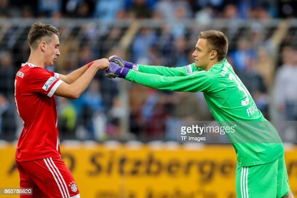 Adrian Fein of Bayern Muenchen and goalkeeper Christian Fruechtl of Bayern Muenchen celebrate their win during the match between TSV 1860 Muenchen...