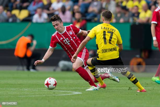 Adrian Fein of Munich and Alexander Laukart of Dortmund battle for the ball during the U19 German Championship Final match between U19 Borussia...