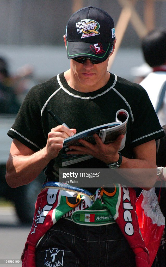 '<a gi-track='captionPersonalityLinkClicked' href=/galleries/search?phrase=Adrian+Fernandez&family=editorial&specificpeople=167077 ng-click='$event.stopPropagation()'>Adrian Fernandez</a> during IndyCar - 2004 Bridgestone Indy Japan 300 - Day 2 at Twin Ring Motegi Super Speedway in Motegi, Japan. (Photo by Jun Sato/WireImage)'