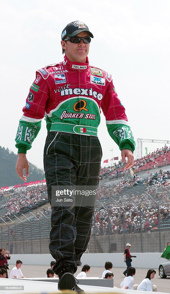'<a gi-track='captionPersonalityLinkClicked' href=/galleries/search?phrase=Adrian+Fernandez&family=editorial&specificpeople=167077 ng-click='$event.stopPropagation()'>Adrian Fernandez</a> during IndyCar - 2004 Bridgestone Indy Japan 300 - Day 3 - Opening Ceremony - Pit Lane at Twin Ring Motegi Super Speedway in Motegi, Japan. (Photo by Jun Sato/WireImage)'