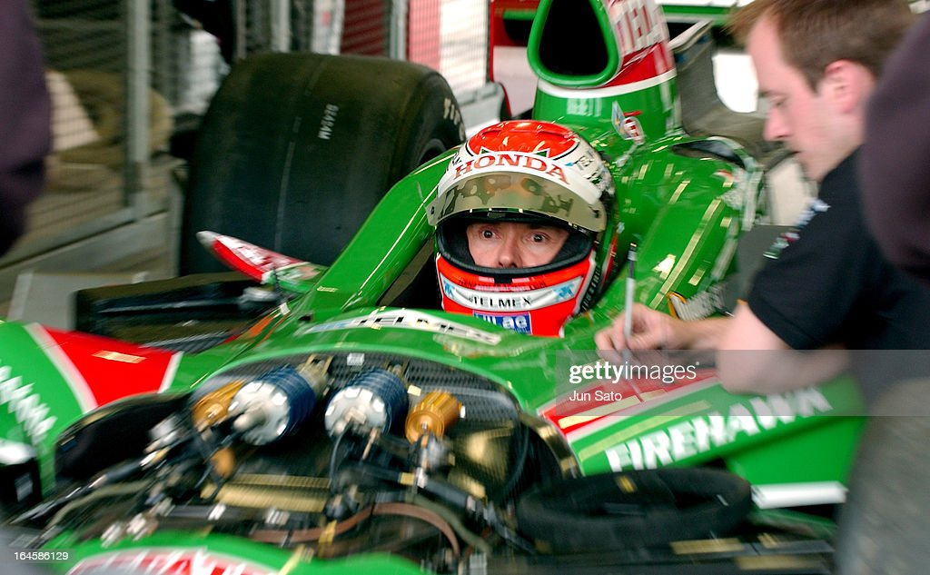 '<a gi-track='captionPersonalityLinkClicked' href=/galleries/search?phrase=Adrian+Fernandez&family=editorial&specificpeople=167077 ng-click='$event.stopPropagation()'>Adrian Fernandez</a> during IndyCar - 2004 Bridgestone Indy Japan 300 - Preparation - Day 1 at Twin Ring Motegi Super Speedway in Motegi, Japan. (Photo by Jun Sato/WireImage)'