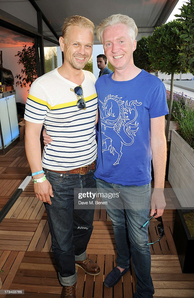 Adrian Fillary (L) and <a gi-track='captionPersonalityLinkClicked' href=/galleries/search?phrase=Philip+Treacy+-+Fashion+Designer&family=editorial&specificpeople=12819932 ng-click='$event.stopPropagation()'>Philip Treacy</a> attend the Barclaycard UNWIND VIP lounge at British Summer Time Hyde Park presented by Barclaycard on July 13, 2013 in London, England.