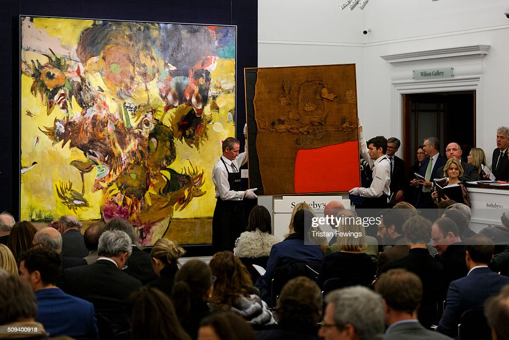 Adrian Ghenie's Sunflowers in 1937, 2014 and Italian master Alberto Burri's Sacco e Rosso, c1959 are sold at the Contemporary Art Evening Sale at Sotheby's on February 10, 2016 in London, England. Ghenie's Sunflowers acheived a record £3.1m and Burri's Sacco e Rosso achieved a new record of £9.1m.