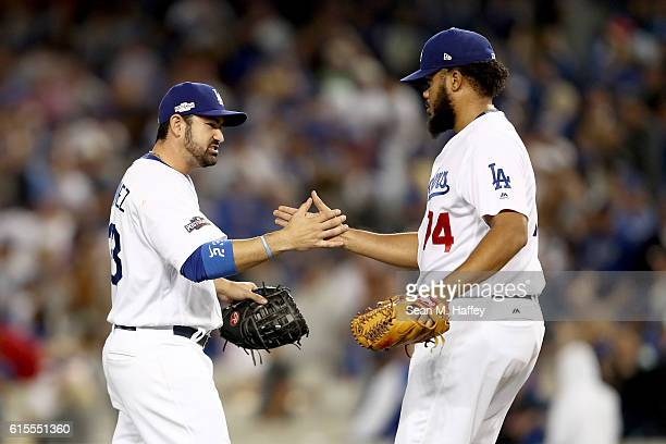 Adrian Gonzalez and Kenley Jansen of the Los Angeles Dodgers celebrate the Dodgers 60 win against the Chicago Cubs in game three of the National...