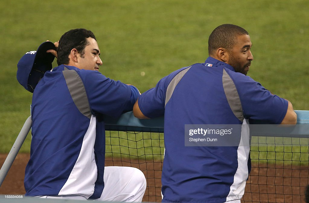 Adrian Gonzalez #23 (L) and Matt Kemp #27 of the Los Angeles Dodgers watch from the dugout steps after being taken out of the game wtih the San Francisco Giants on October 3, 2012 at Dodger Stadium in Los Angeles, California. The Dodgers won 5-1.
