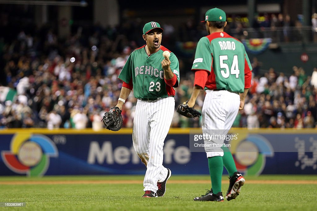 Adrian Gonzalez #23 and <a gi-track='captionPersonalityLinkClicked' href=/galleries/search?phrase=Sergio+Romo&family=editorial&specificpeople=5433590 ng-click='$event.stopPropagation()'>Sergio Romo</a> #54 of Mexico celebrate after Mexico won 5-2 against the United States during the World Baseball Classic First Round Group D game at Chase Field on March 8, 2013 in Phoenix, Arizona.